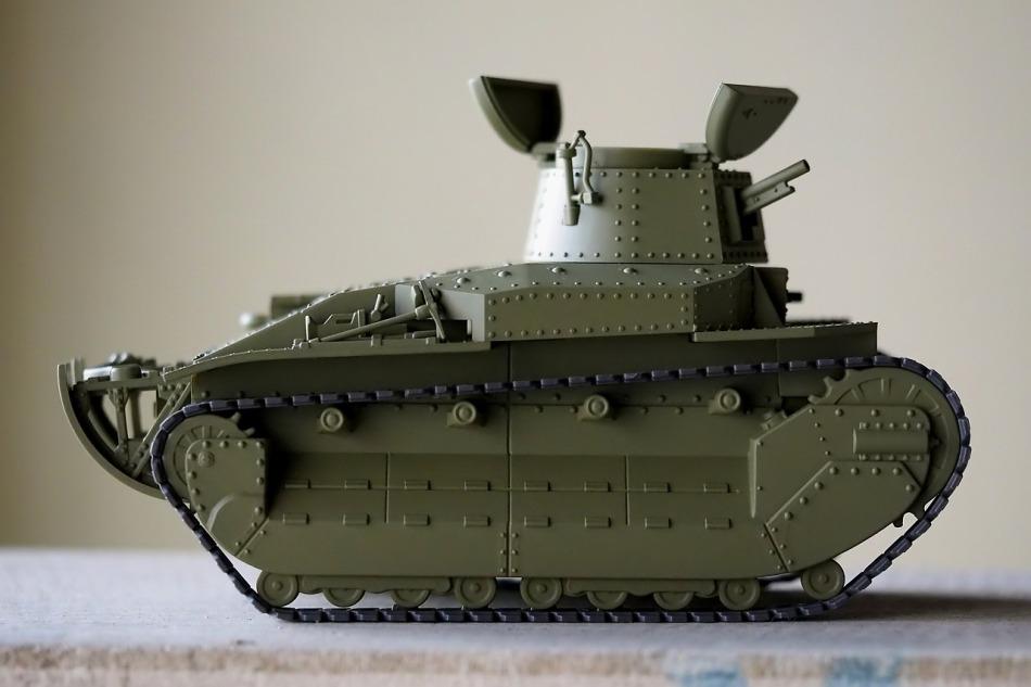 Green tank model on table