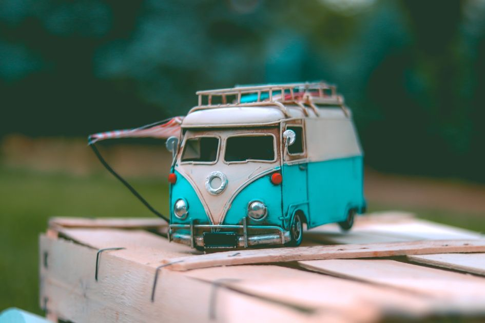 White and teal volkswagen van on the box